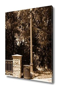 Ashley Canvas A Garbage Can Stands Next To A Lamppost In The