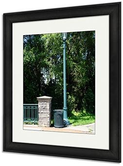 Ashley Framed Prints A Garbage Can Stands Next To A Lamppost