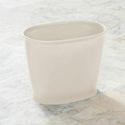 small plastic oval trash can garbage wastebasket