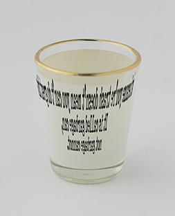 Shot glass with gold rim of Just because you're trash doesn'